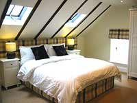 Double bedroom at Weavers Hall self-catering cottage, Newburgh, Fife, Scotland, UK